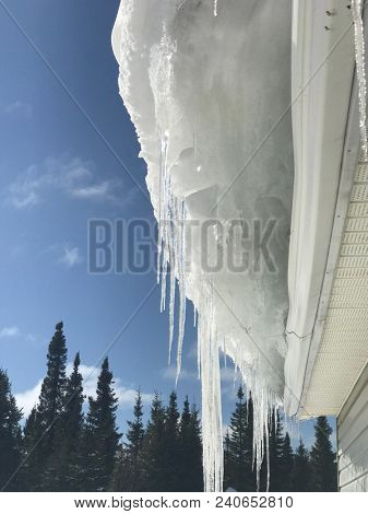 Ice and Snow buildup of roof of house