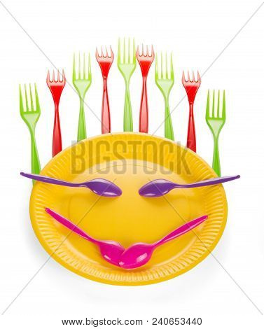 Stylized Smiley Face From Set Of Disposable Plastic Tableware Isolated On White Background