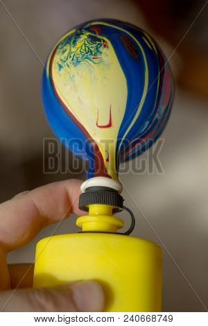 Inflating A Balloon With The Yellow Pump