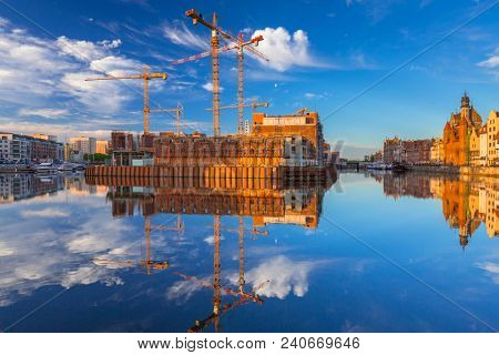 Olowianka island with building construction in Gdansk at sunrise, Poland.