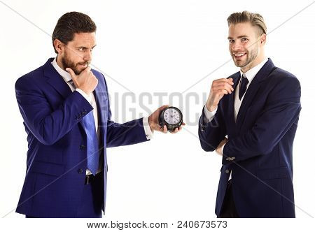Business And Punctuality Concept. Businessmen Misunderstanding About Timing. Men In Classic Suits Wi