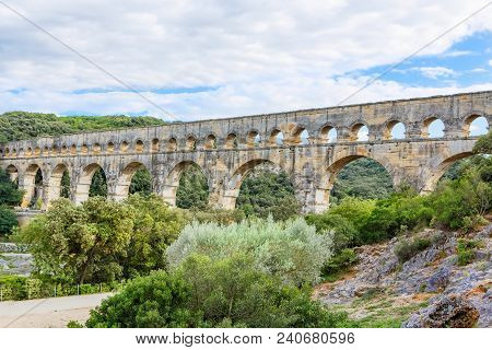 Pont Du Gard Is An Old Roman Aqueduct Near Nimes In Southern France. Travel Destination For Tourists