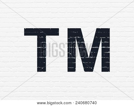 Law Concept: Painted Black Trademark Icon On White Brick Wall Background