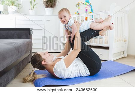 Happy Mother Doing Fitness Exercises With Her 9 Months Old Baby Boy