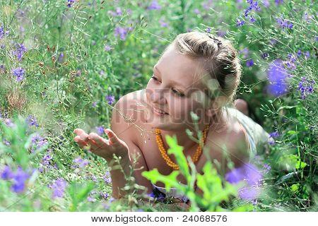 Young Girl Lying Among The Flowers