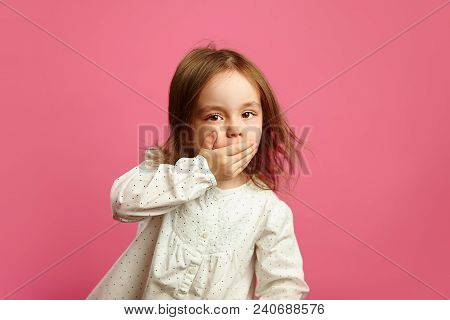 Portrait Of Little Girl Covered Her Mouth With Hand, Has A Stunned Face, Said Bad Word, Feels Consci
