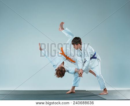 The Teen Boys Fighting At Aikido Training In Martial Arts School. Healthy Lifestyle And Sports Conce