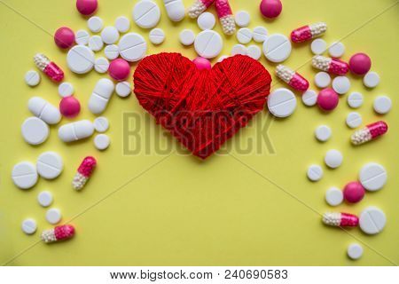Red Heart With Different Pills Over White Background, Healthy Life Concept.heart Disease, Heart Cond
