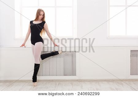 Young Graceful Ballerina In Black Practicing Pointe Exercises At Ballet Class. Classical Dancer In W