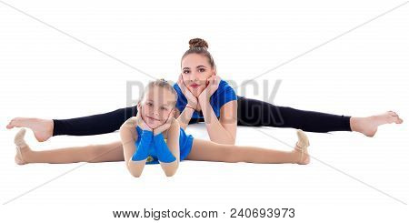 Beautiful Flexible Woman And Little Girl Doing Stretching Exercise Isolated On White Background