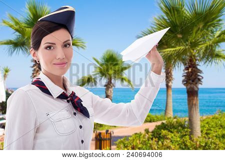 Vacation And Travel Concept - Beautiful Stewardess With Paper Plane Over Summer Beach Background