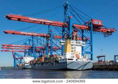 Hamburg, Germany - May 8, 2018: Feeder ships CHARLOTTA B and LANTAU ARROW at container terminal Burchardkai