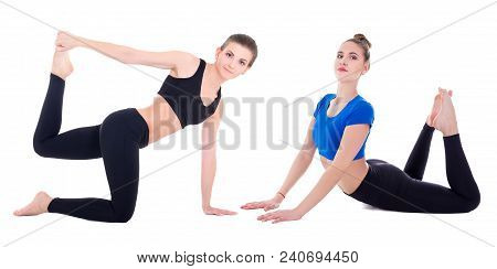 Two Young Beautiful Sporty Women Doing Stretching Exercises Isolated On White Background