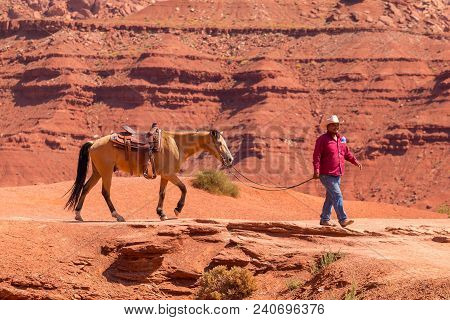 Monument Valley, Arizona, Usa- 02 September 2017: Man Leading A Horse In The Monument Valley, Navajo