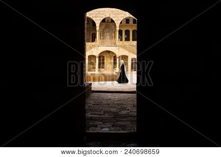Beit ed-Din, Lebanon - October 6 2015: View trough entrance tunnel with lady passing by at Emir Bachir Chahabi Palace Beit ed-Dine on sunny day in mount Lebanon Middle east