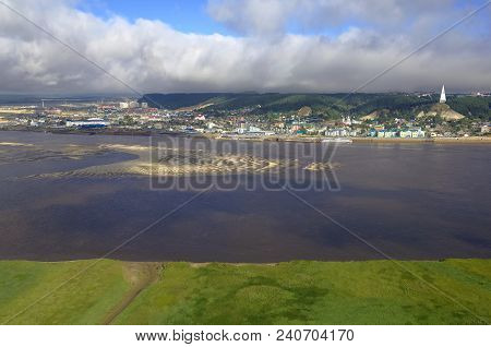 Panoramic View Of The City Of Khanty-mansiysk, Siberia, Russia.in The Foreground-green Bank Of The I