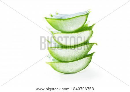 Natural Cosmetic With Aloe Vera Gel And Rock Salt On Wooden Background. Closeup Sliced Aloe Vera Lea