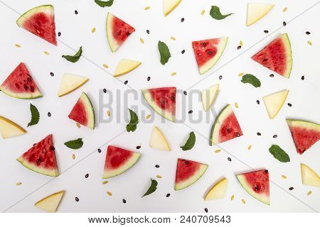 Top View Of Watermelon And Melon Pieces, Mint Leaves And Watermelon And Melon Seeds Isolated On Whit