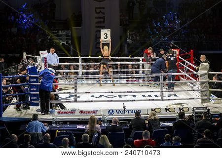 Brovary. Ukraine, 14.11.2015 Ring Girl Stands With Her Back Inside The Boxing Ring And Holds A Placa