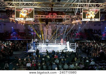 Brovary. Ukraine, 14.11.2015 Empty Boxer Ring Before Boxing Match. Scoreboards With Annonce Of The M