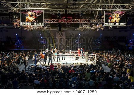 Brovary. Ukraine, 14.11.2015 Photographers Take Photos Of Boxing Winner On The Boxing Ring. Scoreboa