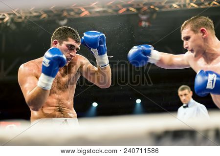 Brovary. Ukraine, 14.11.2015 Two Professional Boxers In Blue Boxing Gloves Are Boxing In The Boxing