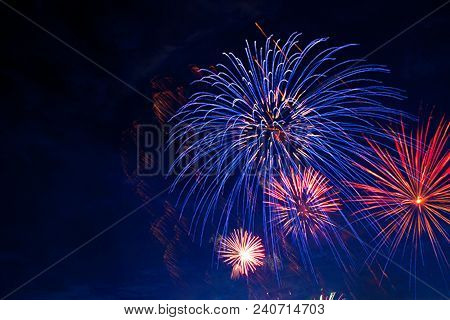 Fireworks In Sky Twilight. Fireworks Display On Dark Sky Background. Independence Day, 4th Of July,