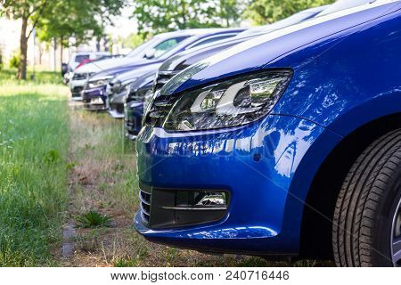 Modern Cars Parking On An Urban Parking Spot
