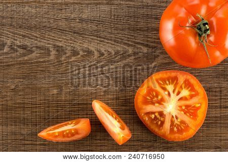 Red Tomato Collection Isolated On Brown Wood Background Top View One Whole One Section Half And Two