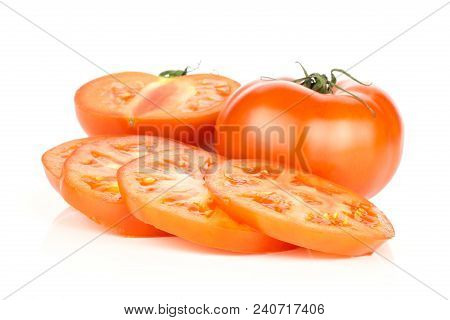 Sliced Red Tomato Isolated On White Background One Whole One Half And Three Circle Slices