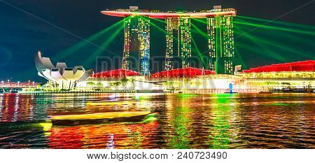 Singapore - April 27, 2018: Colorful Laser Show At Night At Marina Bay Sands Hotel Casino And Artsci