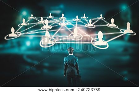 Young Businessman In Front Of Network Of People.