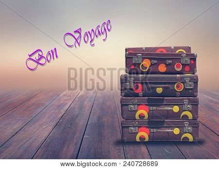 Shabby Vintage Ancient Suitcases.  Background Of Wooden Boards.  Concept Travel  With The Inscriptio