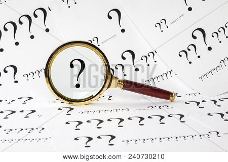 Question Concept - A Conceptual Look At  Questions. A Magnifyimg Glass Over A Question Mark, And A Q
