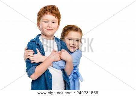 Adorable Redhead Siblings Hugging And Smiling At Camera Isolated On White