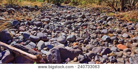 A Dry Creek Bed Near Sedona Arizona That Is Filled With Rock, Stones And Small Boulders.