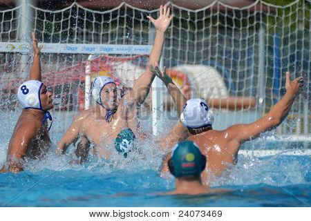 KAPOSVAR, HUNGARY - OCTOBER 1: Csaba Bako (white 8) in action at a Hungarian national championship water-polo game Kaposvar (white) vs. Honved (green) on October 1, 2011 in Kaposvar, Hungary