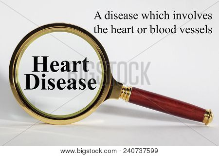 Heart Disease Concept - Looking At Heart Disease Through A Magnifying Glass.