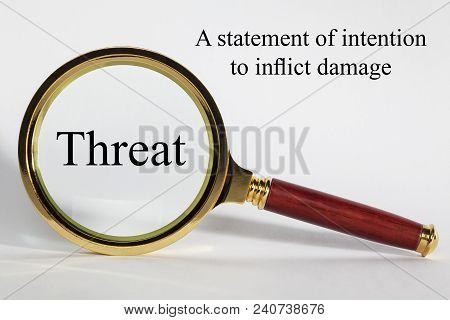 Threat  Concept - Looking At Threat Through A Magnifying Glass, And Definition.