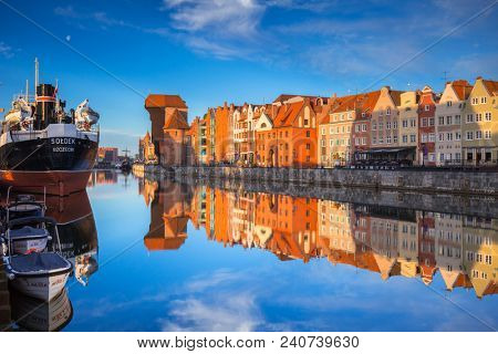 Gdansk, Poland - May 5, 2018: Old town of Gdansk reflected in the Motlawa river at sunrise, Poland. Gdansk is the historical capital of Polish Pomerania with beautiful architecture.
