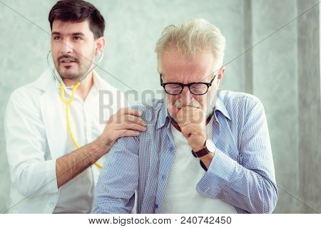 Senior Patient Having Consultation And Examination Physical With Doctor In Examination Room., Health