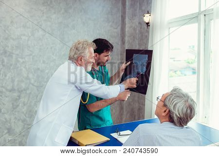 Portrait Of Doctor Team Are Examining X-ray Film For Patient In Examination Room., Healthcare And Oc
