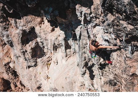 A Woman Climbs The Rock. Climbing In Nature. Fitness Outdoors. Active Lifestyle. Extreme Sports. The