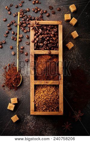 Food Background With Three Kinds Of Coffee: Beans, Milled, Instant In Wooden Box On Old Concrete Bro