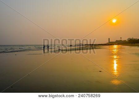 Beautiful Sea Shore At Sunrise Or Sunset Sunset Wild Empty Tropical Beach, Orange Sky, Sunlight Refl