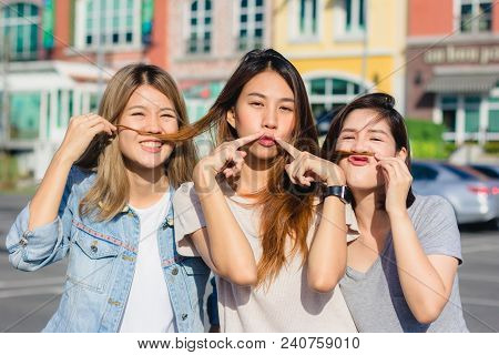Happy Young Asian Women Group City Lifestyle Playing And Chatting Each Other Among The Pastel Buildi