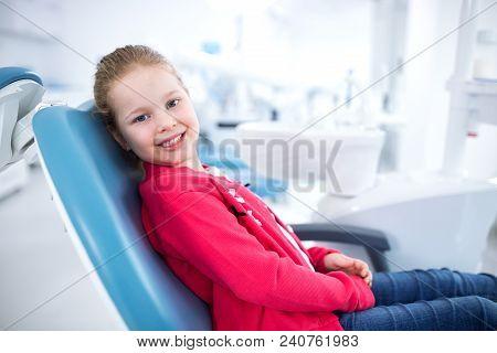 Beautiful Smiling Little Girl In Dental Office