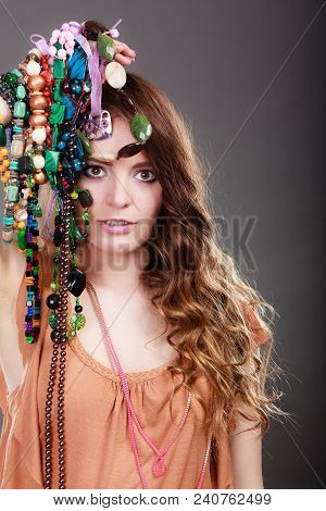 Pretty Young Woman Wearing Bracelets Holding Many Plentiful Of Precious Jewelry Necklaces Beads. Por