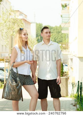 Love, Romantic Walks Concept. Man And Blonde Woman Walking In City On Sunny Day Enjoying Romance, Ha