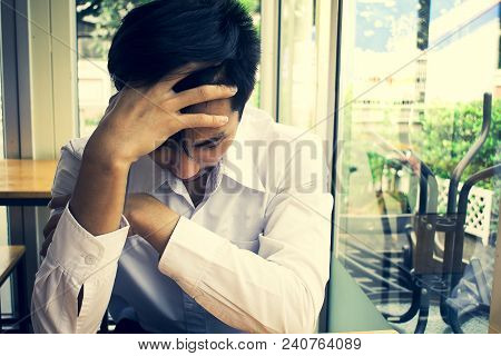 Man Writing On Office Blurred Background Metaphor Problem To Business  Or Unemployed And Sad With De
